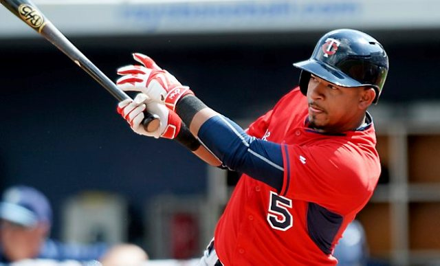 Twins infielder Eduardo Escobar hits a single against Tampa Bay pitcher Brandon Gomes in the fifth inning at Charlotte Sports Park in Port Charlotte, Fla. on Friday, March 6, 2015. The Ray beat the Twins, 2-1. (Pioneer Press: John Autey)